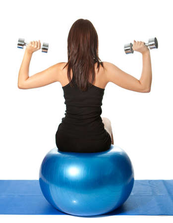Yoing women doing weight training photo