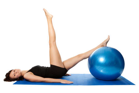 Young women doing pilates on fitness ball photo