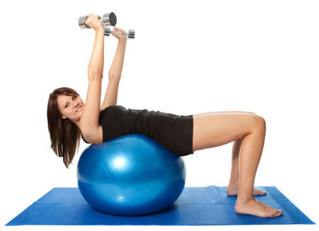 back training: Yoing women doing weight training Stock Photo