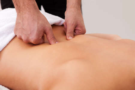 chiropractic: Young beautiful woman getting back massage