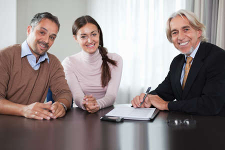 financial executive: Financial advisor in meeting with a young couple