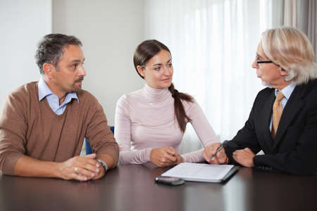 Couple in meeting with a financial planner photo