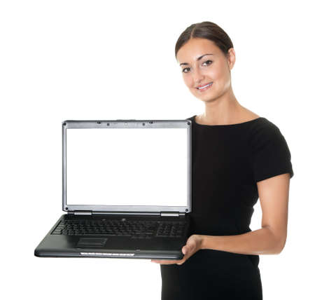 Pretty lady presenting a new laptop on white photo