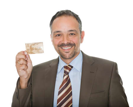 Mature businessman showing a credit card photo