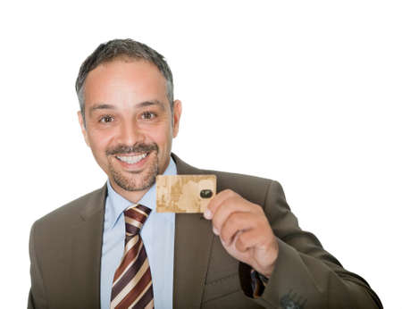 Happy businessman holding a credit crad Stock Photo - 10694880