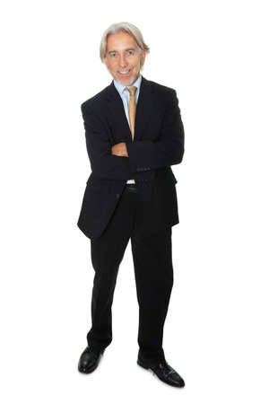 Mature businessman standing on white background photo
