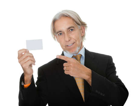 Mature executive showing a empty business card Stock Photo - 10759002