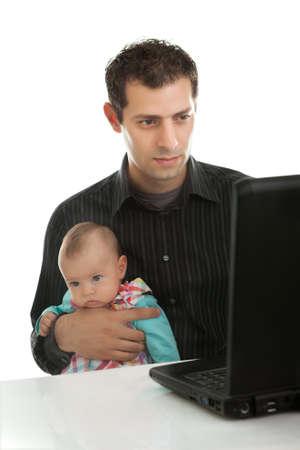 babysitting: Father working on laptop while babysitting