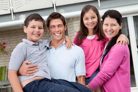 Portrait of beautiful young family having fun outdoors Stock Photo - 10985526
