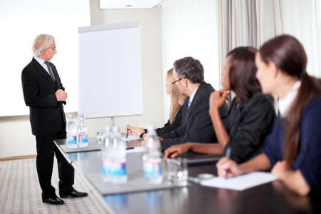 Successful young male business executive heading a business conference Stock Photo - 11079978