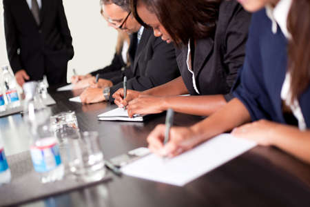 Group of business executives taking notes during a meeting at office Stock Photo - 11080341