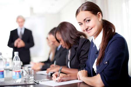 Mature businessman conducting training professionals taking notes Stock Photo - 11080300