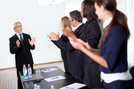 Colleagues congratulating a business man during a business meeting Stock Photo - 11079863