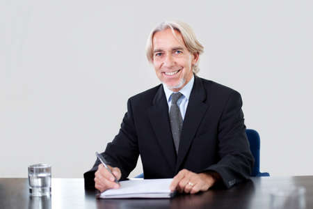 Portrait of a happy mature male entrepreneur working at the office Stock Photo - 11079931