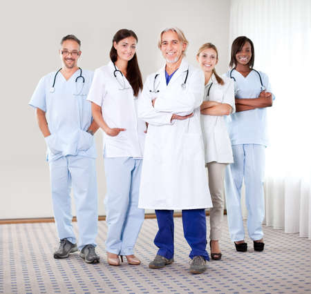 experienced: Portrait of a group of mature doctors standing together at the hospital