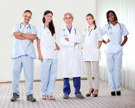 dental nurse: Successful happy group of doctors with stethoscope at the hospital