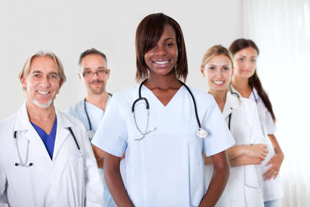 multi ethnic: Friendly group of successful happy multi-ethnic doctors smiling at the camera