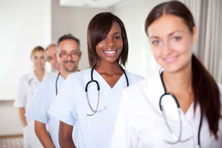 Group of doctors standing at a hospital in a row - Smiling at the camera photo