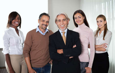 ethnic women: Portrait of successful team of business professionals standing together. Stock Photo
