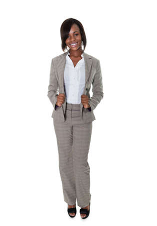 Portrait of beautiful African American female executive posing over white background.