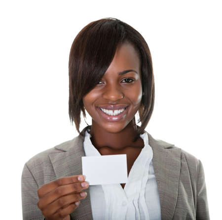 holding business card: Portrait of smiling female executive with business card on white background.