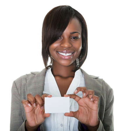 businesswoman card: Portrait of young African American businesswoman holding blank card on white background. Stock Photo