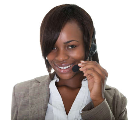 representatives: Happy business woman wearing a headset on white background.