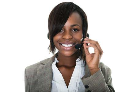 Portrait of smiling female customer services representative on white background.