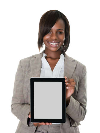 Confident female executive displaying a touchscreen pc isolated on white background. photo