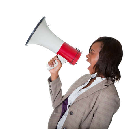 woman shouting: African American businesswoman screaming into a bullhorn isolated on white background.