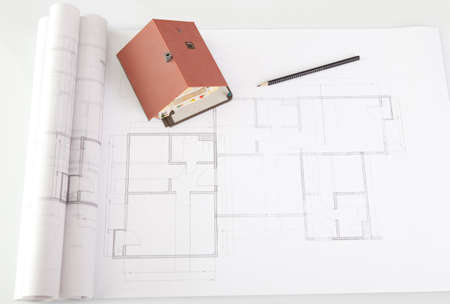 constructors: Image of model house with pencil on architecture construction plan