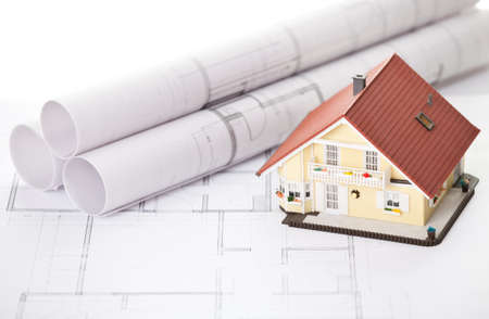 Image of new model house on architecture blueprint plan photo