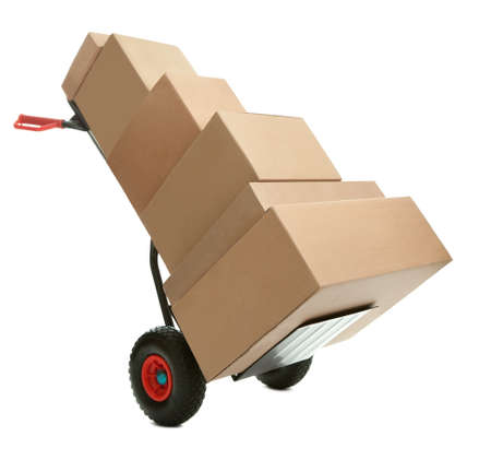 mover: Hand truck with cardboard boxes on it ready for delivery over white background