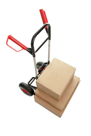 Top view of trolley with cardboard boxes on white background photo