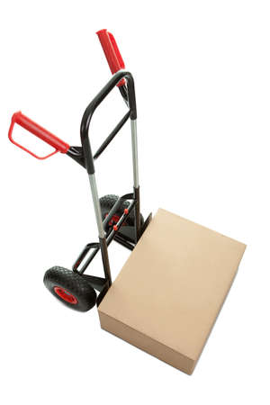 Brown cardboard box on hand truck isolated over white background photo