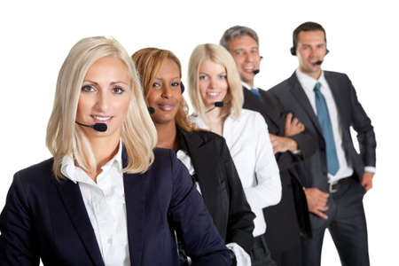 Successful business team with headset on standing in a row against white background photo