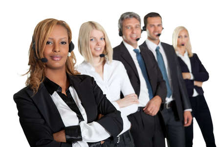 Confident business team with headset standing in a line against white background Stock Photo - 11582285