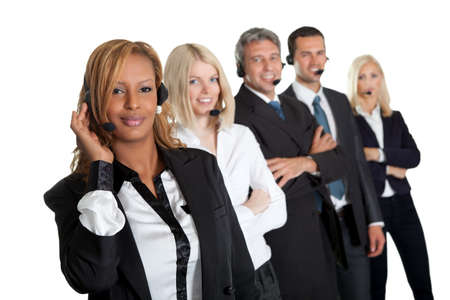 Happy customer service representatives standing in a row against white background photo