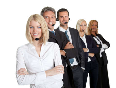 center agent: Positive business team with headset standing in a row against a white background