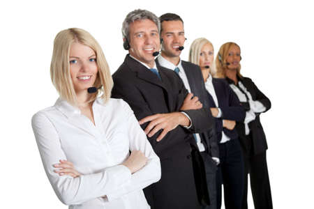 Beautiful female executive wearing headset with colleagues in background photo