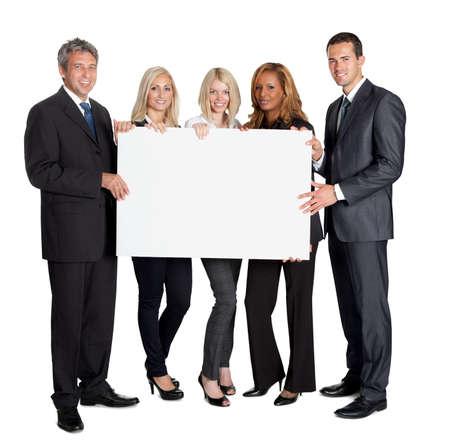Grupo de compañeros de negocios feliz celebración de la cartelera aislado sobre fondo blanco Foto de archivo - 11582958