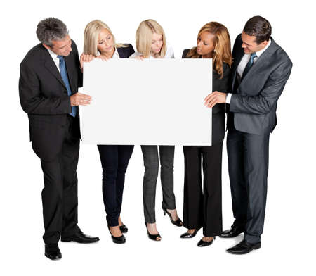 people holding sign: Business people looking at blank board in their hands on white background Stock Photo