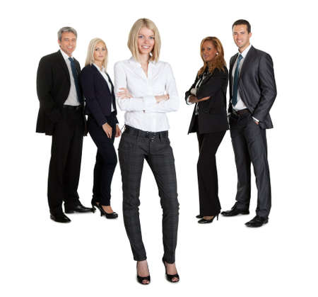 Confident businesswoman with successful group of business people on white background photo