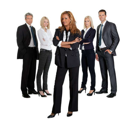 Confident young business executive with her team in the background on white photo