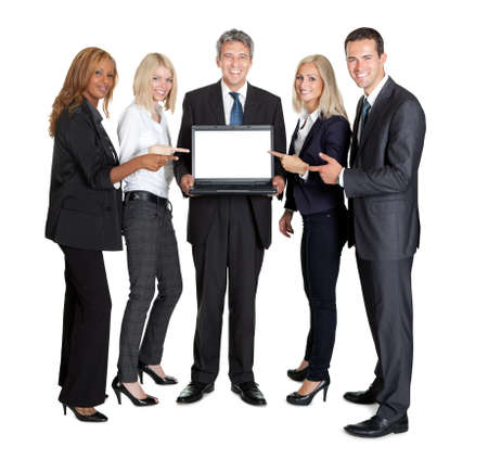 Happy business group pointing at the laptop screen on white background photo