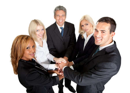 Portrait of successful business people putting their hands on top of each other Stock Photo - 11583292