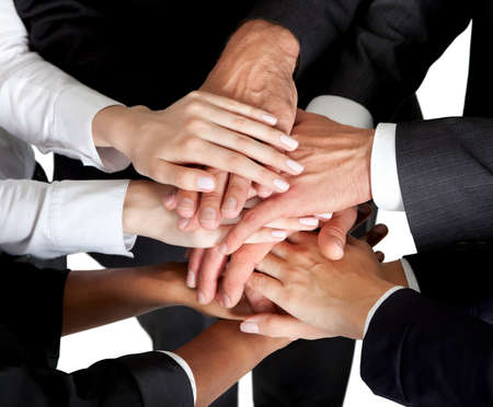 teamwork together: Closeup portrait of group of business people with hands together Stock Photo
