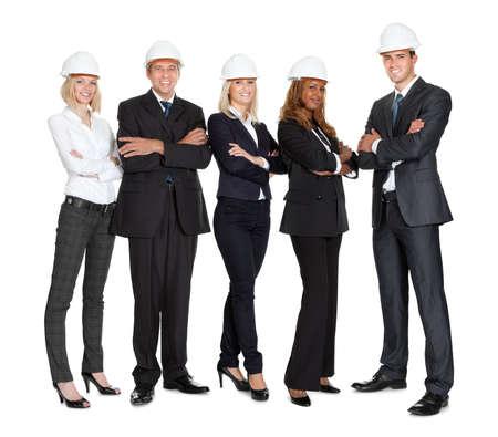 ingeniero civil: Equipo de trabajadores de la construcción con éxito aislado sobre fondo blanco Foto de archivo