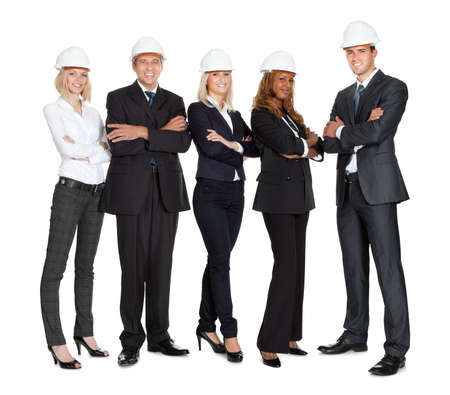 Team of successful construction workers isolated on white background photo