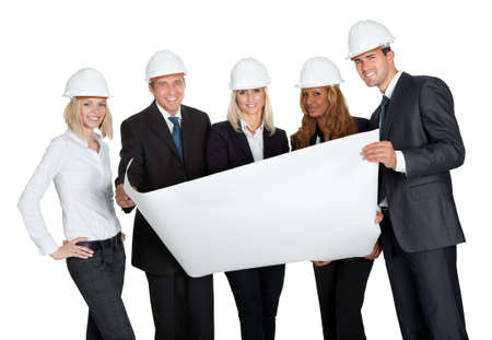 Successful construction workers with building plan isolated on white background photo